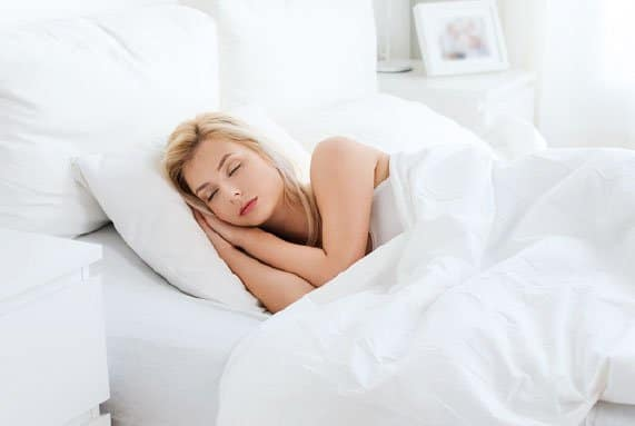pretty lady sleeping peacefully on a boxdrop bed and mattress